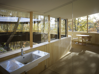 Japanese Home Design A Glass Home Hangs On A Steep Slope