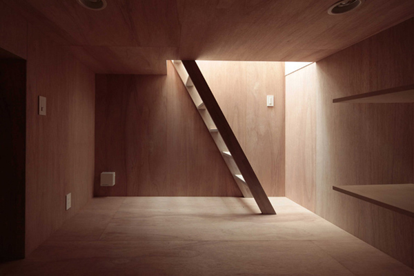 A Japanese House With A Steep Roof