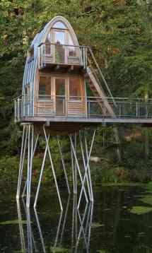 Unusual Forest Cabin Stilts Over Pond Modern House