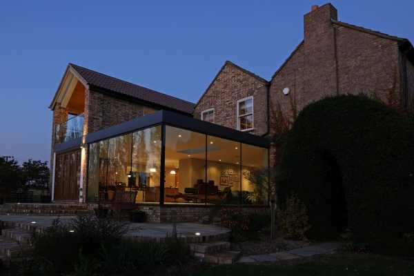 Modern Glass Addition Traditional Home