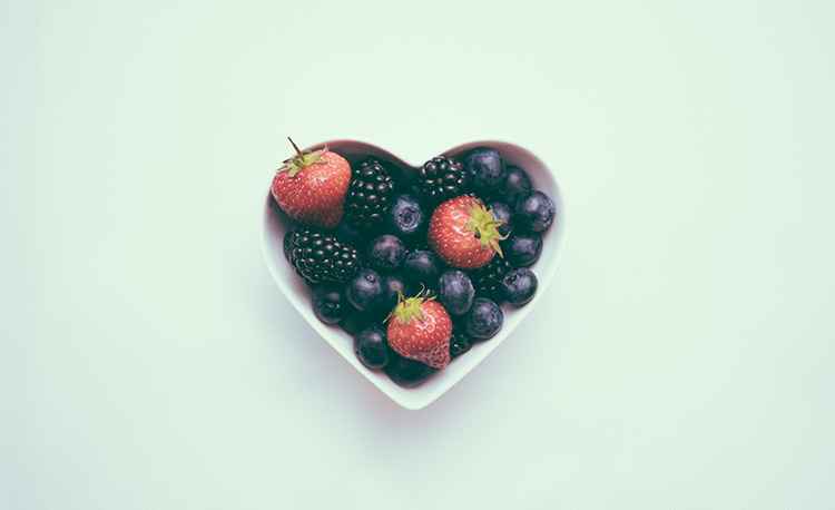 fresh berries in heart shaped bowl