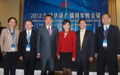 Judy Chu, with Global Chinese Broadcasting Cooperation officials