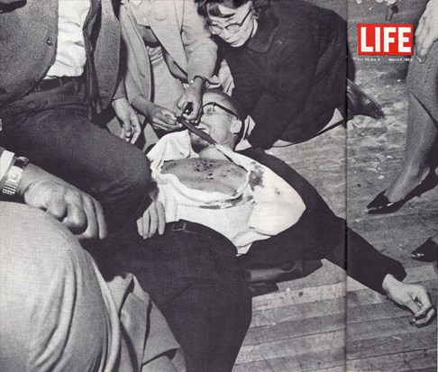 Yuri Kochiyama in photo with Malcolm X after he was shot.