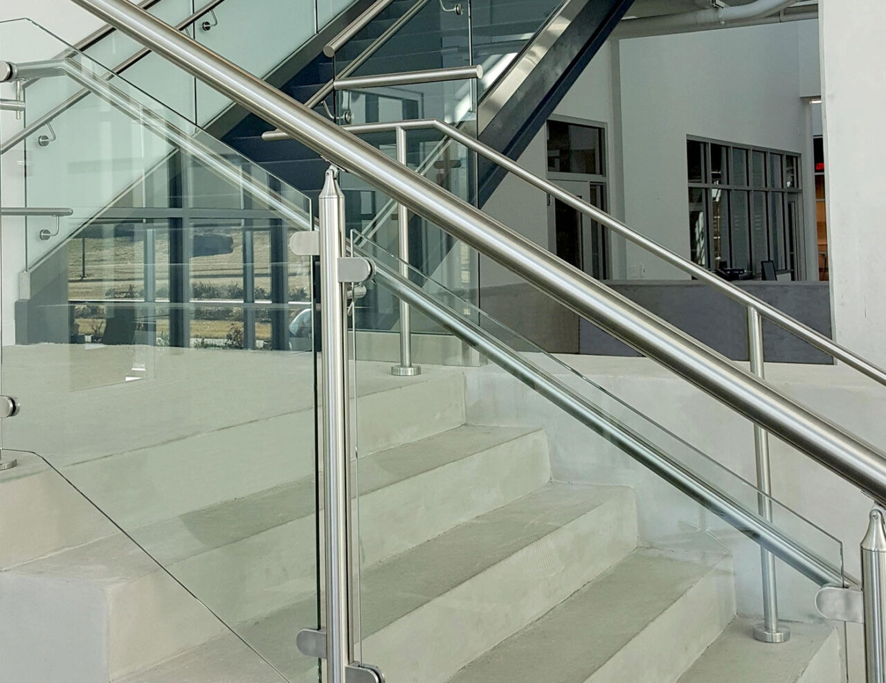 Monaco Post Supported Glass Railing Trex Commercial Products   Staircase Steel Railing Designs With Glass   Banister   Duplex   Button Glass   Exterior Perforated Metal   Glass Balustrade Wood Post