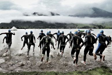 WALCHSEE, AUSTRIA - SEPTEMBER 03: (EDITORS NOTE: This image was produced using a digital filter) Athletes start the swim course during the Challenge Walchsee-Kaiserwinkl Triathlon on September 3, 2017 in Walchsee, Austria. (Photo by Stephen Pond/Getty Images)