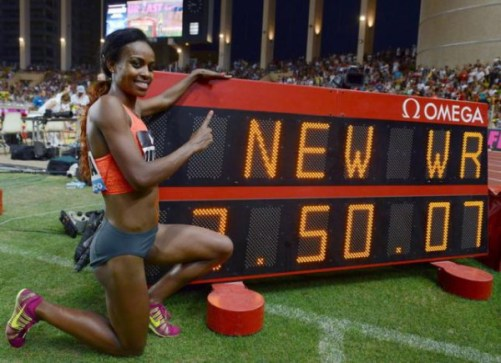 Genzebe Dibaba of Ethiopia celebrates her new world record in the 1500 meters women event at the IAAF Diamond League Herculis meeting at the Louis II Stadium in Monaco