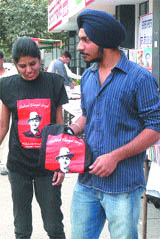 Students buy T-shirts of Shaheed Bhagat Singh in Jalandhar on Friday