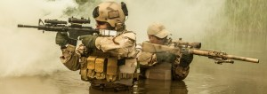 Navy SEALs crossing the river with