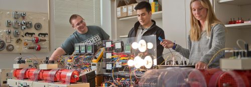 small resolution of students working in electrical engineering lab