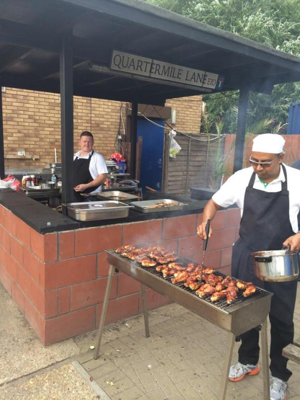 Business fun day with BBQ chicken on the grill