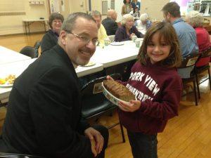 Bringing dessert to Fr. Bartolomeo ...