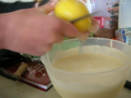 Scraping the surface of the lemons to release the oils