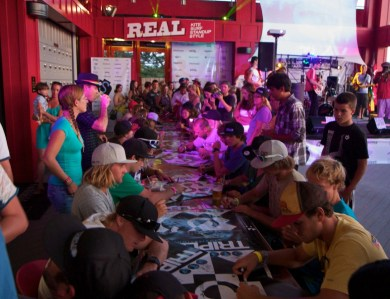 Triple-S poster signing at REAL