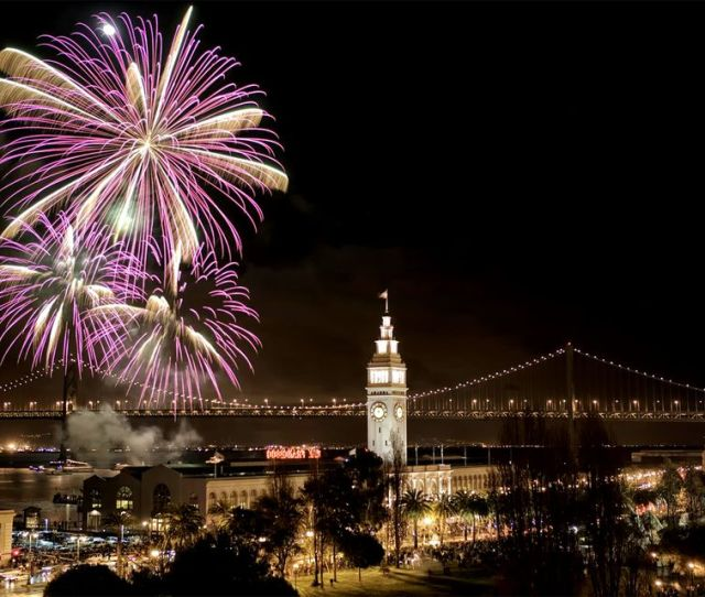 Fireworks Over The Ferry Building And Bay Bridge In San Francisco