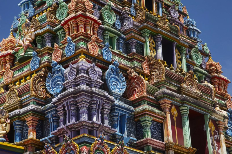 Closeup of the ornate carvings and detailed paintings of the Sri Siva Subramaniya Temple