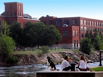 Condos on the Lachine Canal. The bike trails from Atwater Market to the Old Port are lovely. Isn't this a great scene with a couple enjoying a glass of wine on a picnic while their Puppy wants to catch a Northern Pike!