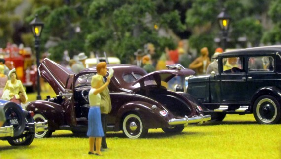 The townsfolk gathered in the local park to visit with neighbors and look at some late model vehicles.