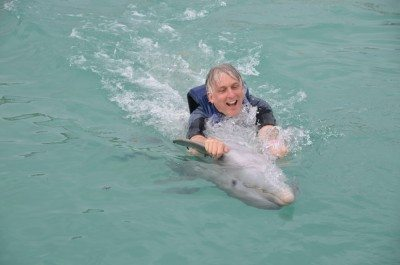Hitching a ride with a friendly dolphin! Too cool!