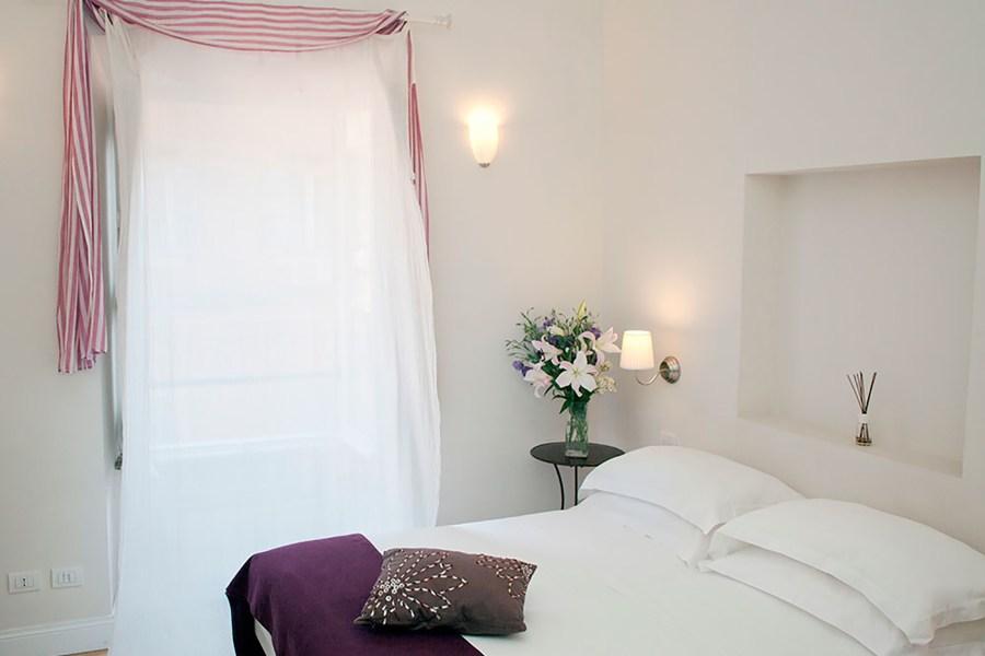 Kahden hengen huone parivuoteella © Amaranto Romano