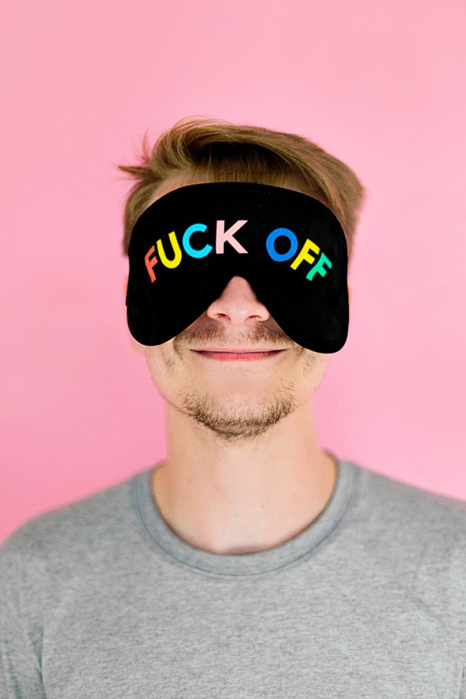 """self-care / easy meditation online pic: man wearing eyemask with """"fuck off"""" written on it"""