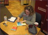 Stephanie signs my books