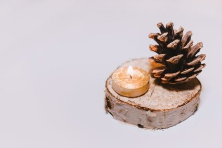 brown-pine-cone-nut-beside-tealight-candle-726227