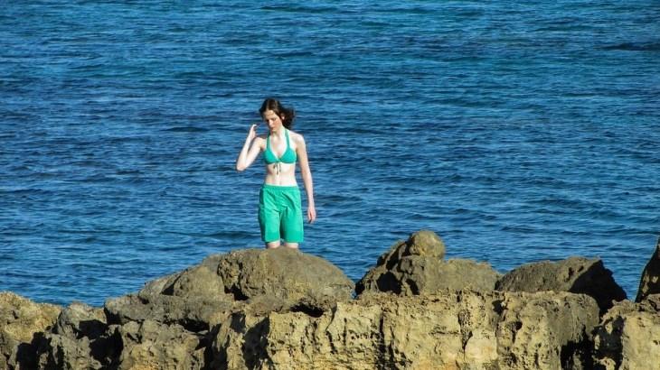 sexy woman walking on the beach