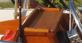 Wood rails around the perimiter of the steering console