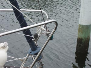 A line from the eye strap on the tip of the MacGregor pole leads to a large snap shackle that snaps around the bow rail.
