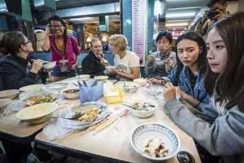 Group of people eating street food at Jingmei Night Market Taipei