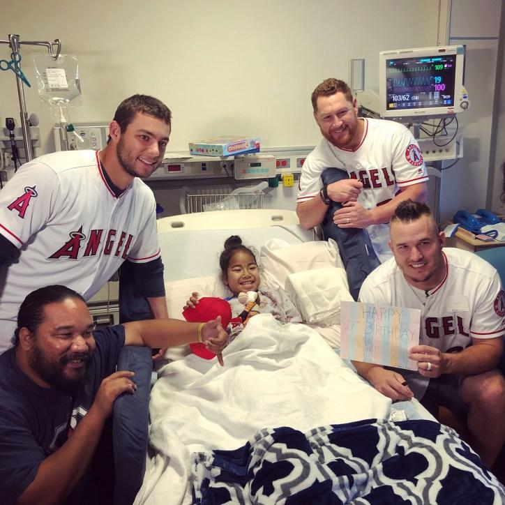 Trout, Fletcher and Calhoun visiting a children's hospital