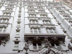 At Royal and Bienville, headed for the Hotel Monteleone, is when the shit hit the fan. Hotel Monteleone (NOLA Cake Architecture) by Bart Everson, via Wikimedia Commons.