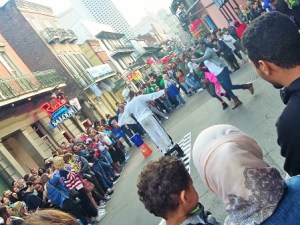 The Dragon Masters from America's Got Talent have a huge crowd assembled in a circle on Bourbon Street.
