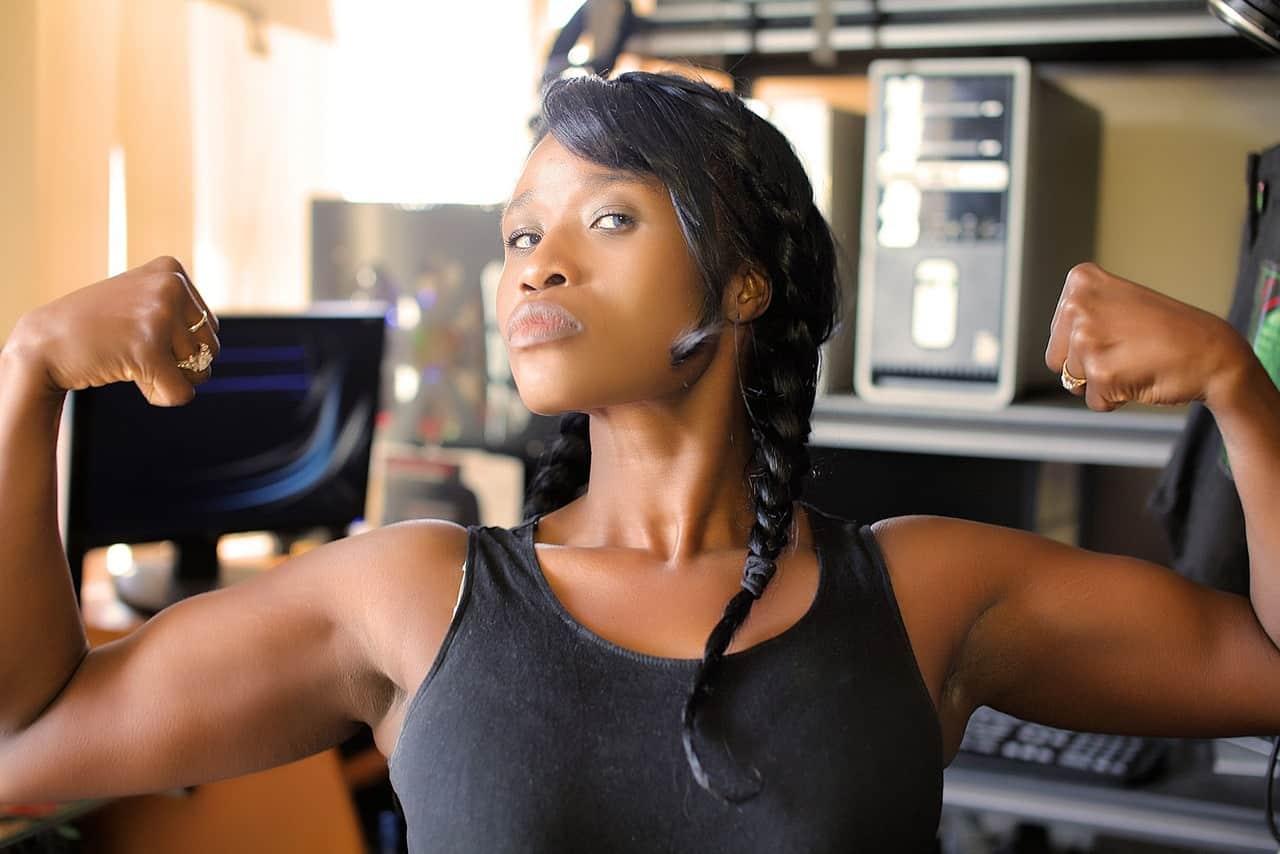 career opps for women in trucking - strong woman flexing
