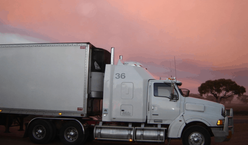 free CDL training - white truck parked alongside of road