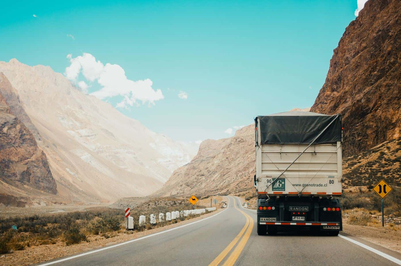truck driving tips - truck hauling minerals into narrow mountain pass