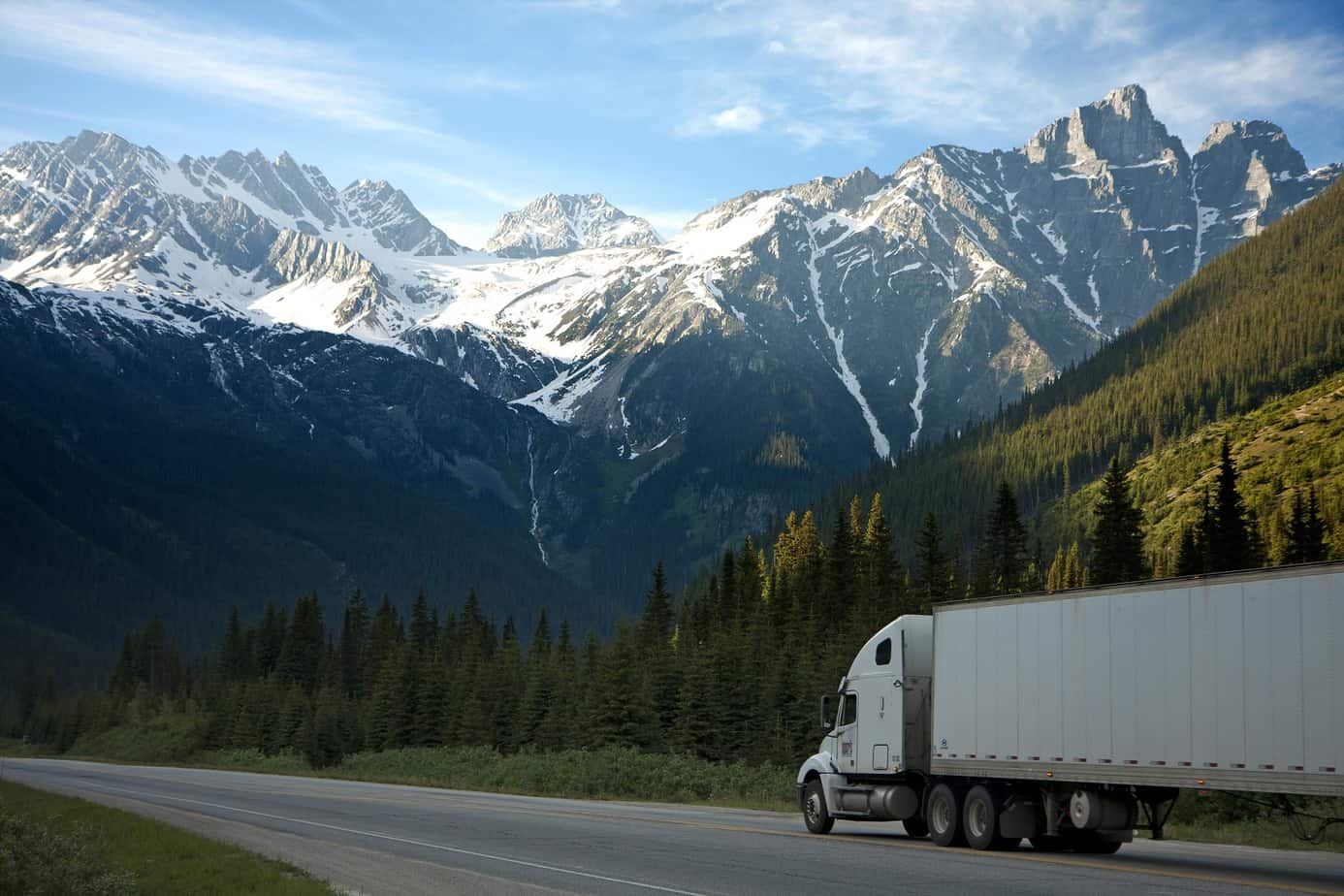 truck driving laws - truck driving on freeway in evergreen mountains