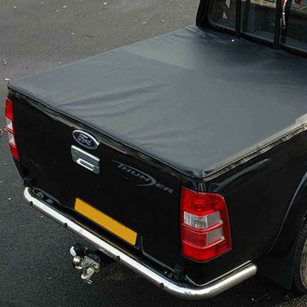 tonneau cover black navara 05 on smoothside ec with ladder rack cut outs