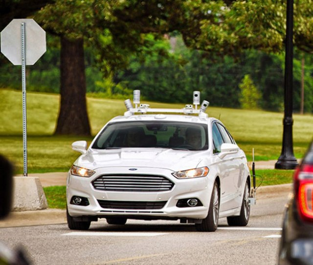 Fords Fully Autonomous Fusion Hybrid Drives The Streets Of Dearborn Michigan The Automaker Plans To Use Technology Like This To Deliver A Fully