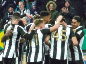 Players celebrate 4th goal