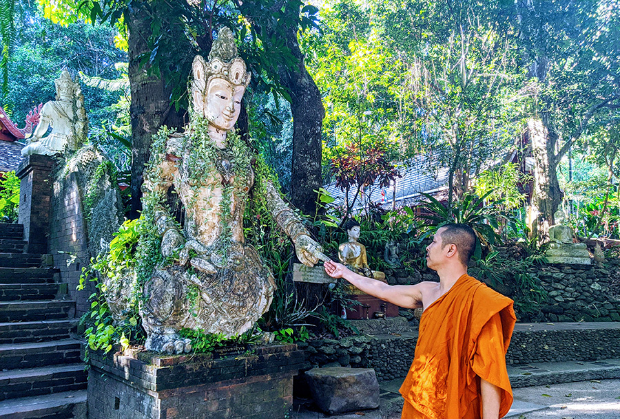 A monk is blessed by the temple