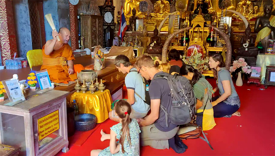 Guests are blessed by a local monk