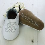 Beautiful personalized baptism shoes with babies Initial on the front, choose from twenty leather colours to match any Baptism outfit. The initial is embroidered with an amazing light catching iridescent thread. They make a perfect Christening or Baptism gift and can be kept in babies memory box as a keepsake after they have been worn to remind you of the special day.