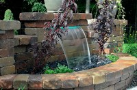 Retaining Wall Waterfalls | True Blue Pond Care