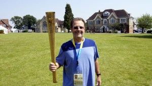 Holding the official Olympic torch in Harpendon, England during 2012 Outreach in London.