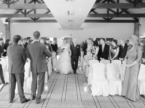 A proud Dad walking his daughter down the aisle at Carden Park