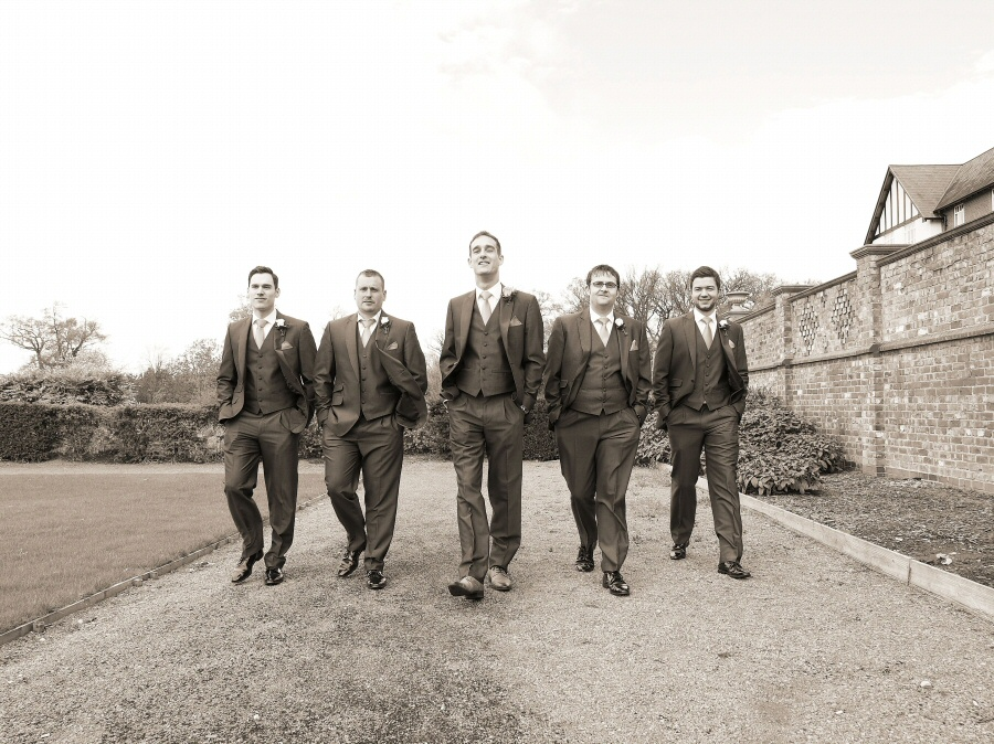 Grooms men walking at Carden Park