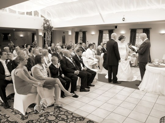 The ceremony n the glass roof function suite in The Plas Hafod