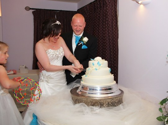 Cutting the cake in the evening reception for their guests to share