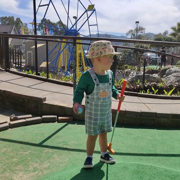 Miniature golf with a miniature Irishman.